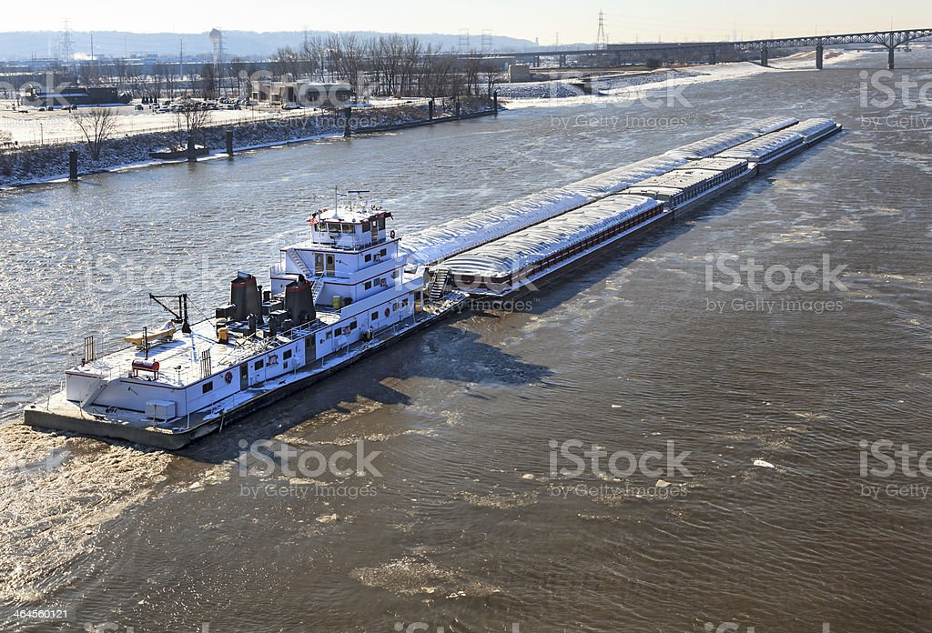 Barge transporting commodities down the river stock photo