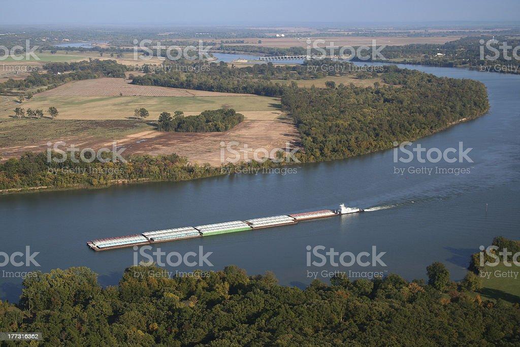 Barge traveling down Arkansas River Dam stock photo
