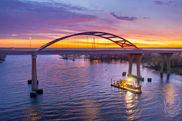 Barge under scenic bridge at daybreak stock photo