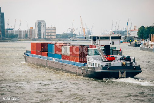 istock Barge with cargo containers 805513340