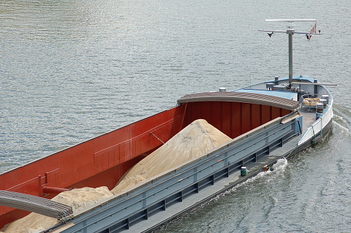 Barge with construction material on mosel river