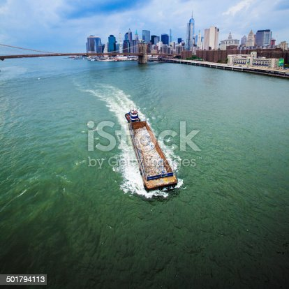istock Barge with garbage at the East River 501794113