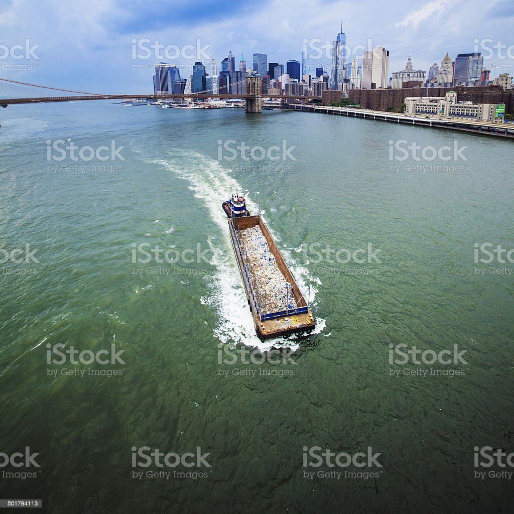 Barge with garbage at the East River stock photo