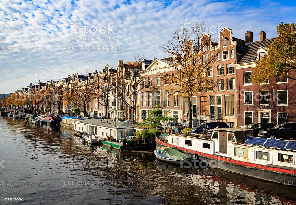 Barges and houses along a canal in Amsterdam stock photo