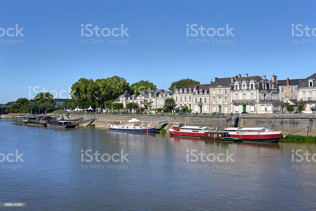 Barges on river at Angers in France stock photo
