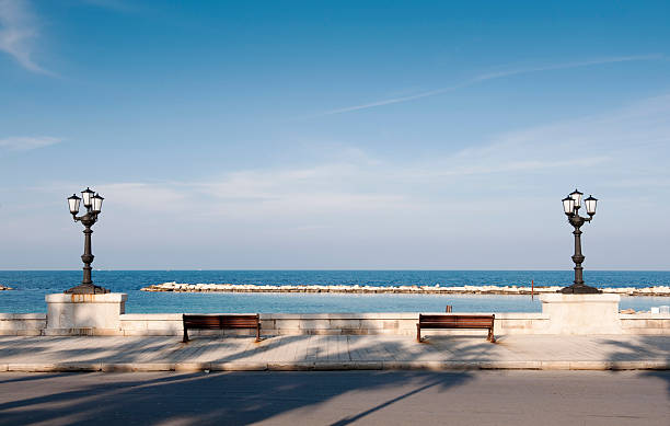 Bari, promenade with bench and lamppost. Apulia - Italy stock photo