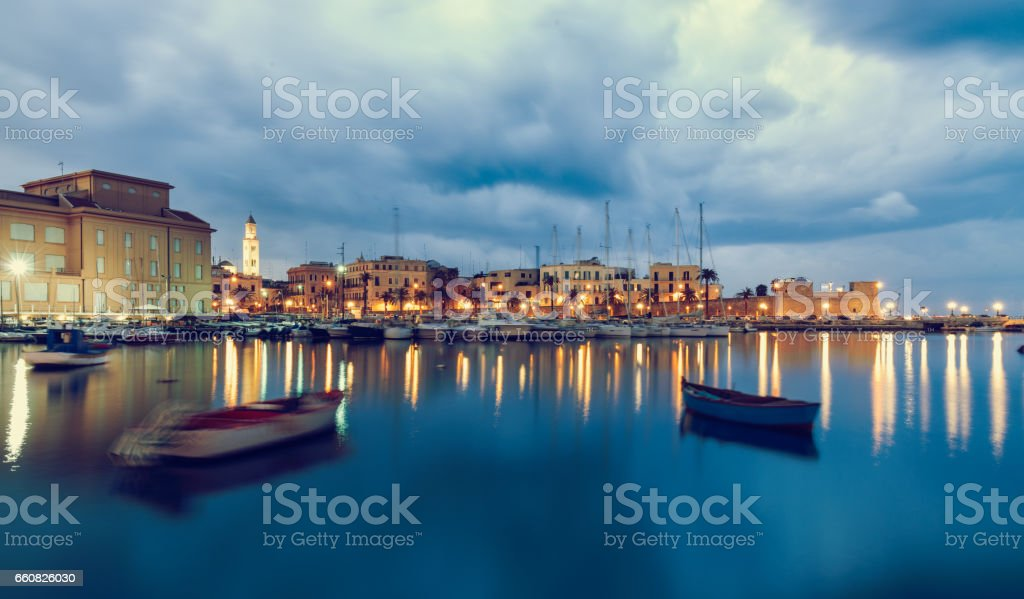 Bari seafront city view from marina. Blue sea and cloudy sky. Long exposure Filtered image stock photo