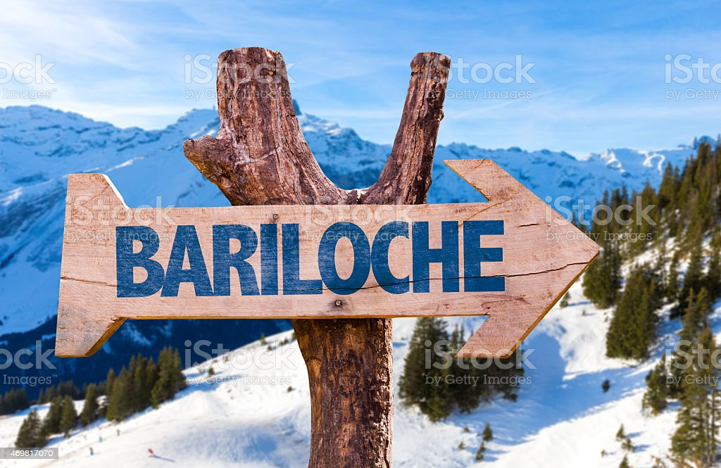 Bariloche wooden sign with alps background stock photo