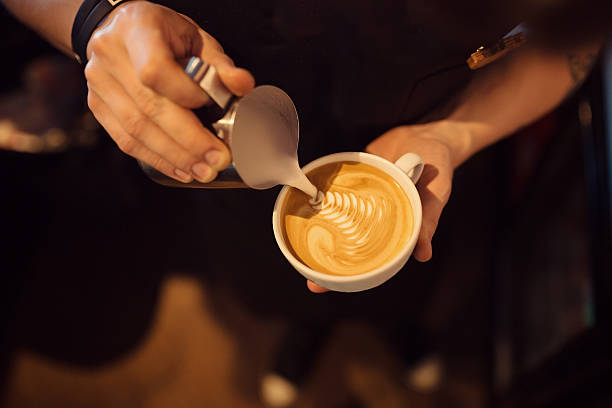 barista at work in a coffee shop. top view - barista making coffee stock photos and pictures