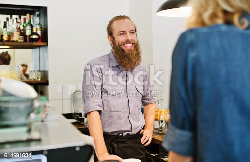 597640822 istock photo Barista attending the male customer 614991634