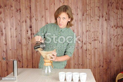 Professional barista preparing fresh coffee alternative method