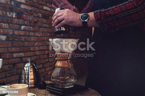 istock Barista brewing coffee 807545088