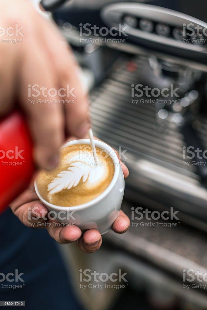 Barista creating latte art stock photo