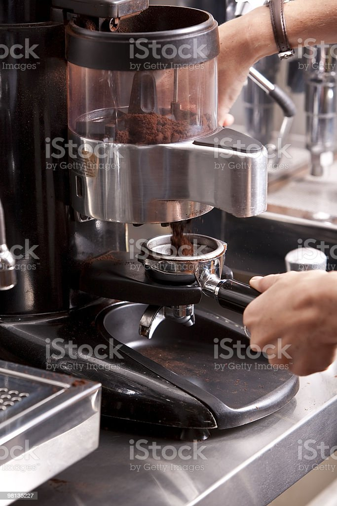 Barista grinding coffee royalty-free stock photo