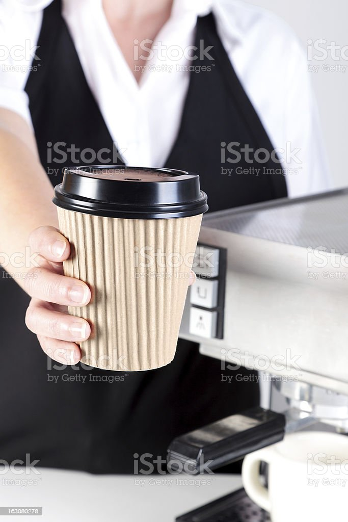 Barista handing you a coffee royalty-free stock photo