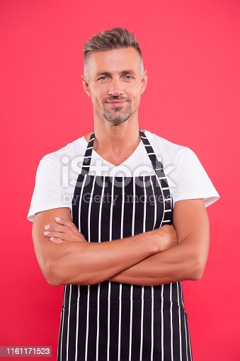 istock Barista handsome worker. Man cook wear apron. Fast food restaurant. Mature barista. Restaurant staff. Hipster professional barista apron uniform. Waiter or bartender. Cafe bar barista job position 1161171523