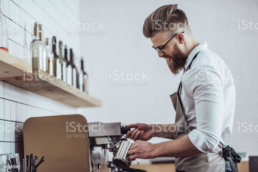Barista in coffee shop stock photo