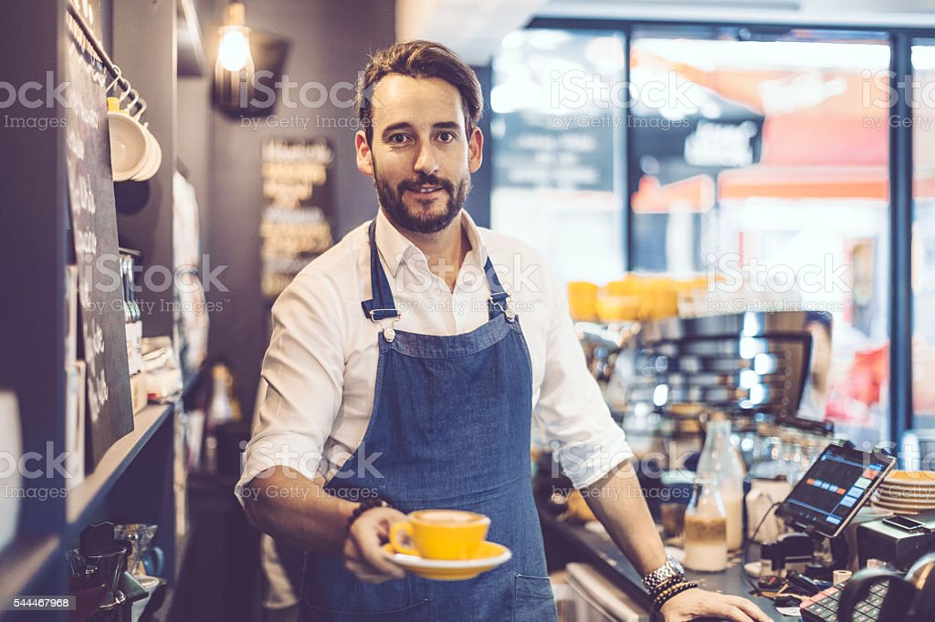 Barista is offering a coffee stock photo