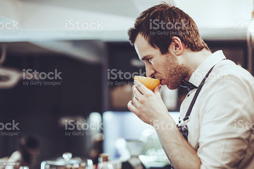 Barista is tasting an espresso stock photo