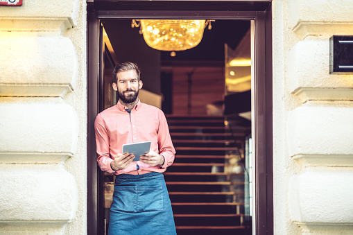 1003493404 istock photo Barista is working in a coffee shop 891653662