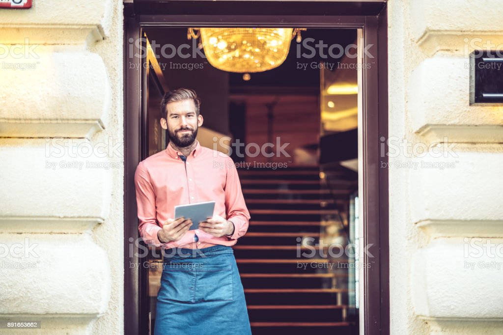 Barista is working in a coffee shop stock photo