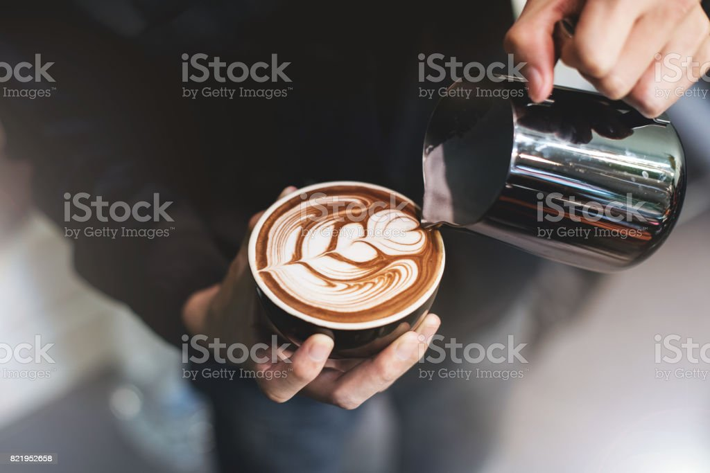 Barista make coffee cup latte art stock photo
