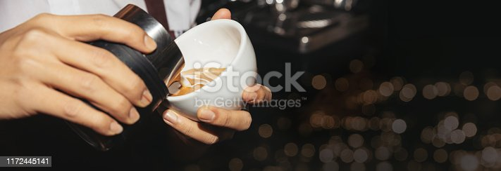 hand of Barista man making a cup of coffee latte art in coffee cafe shop banner