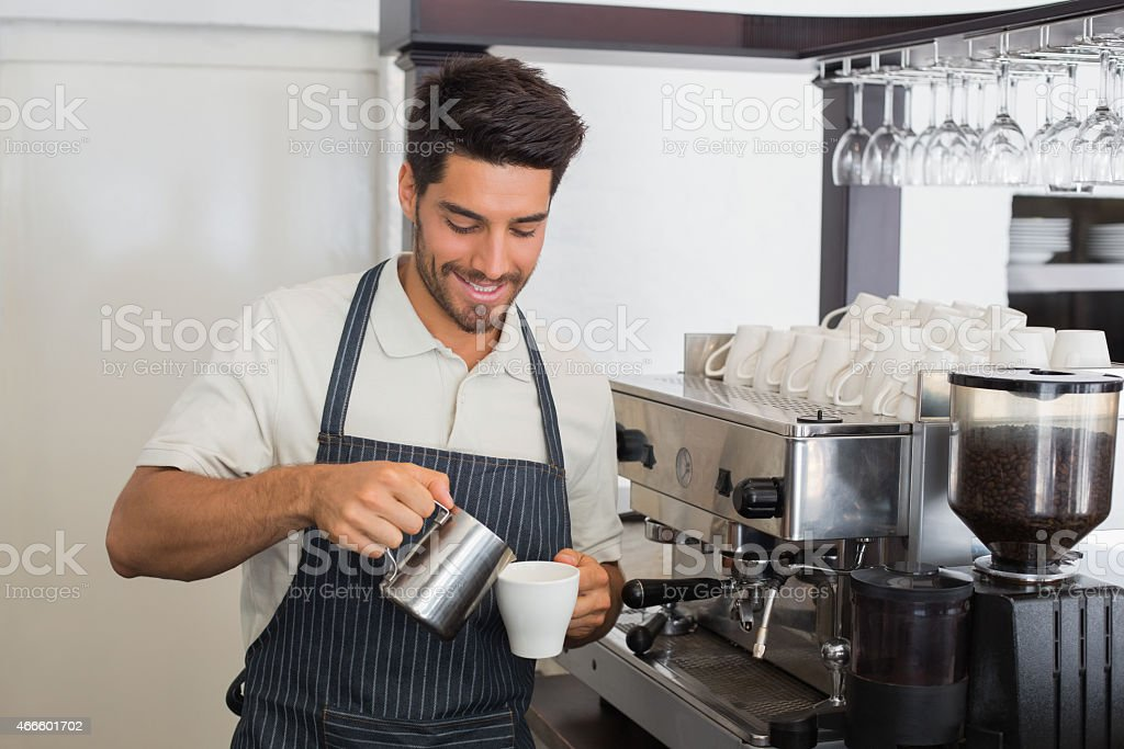 Barista making a cup of coffee stock photo