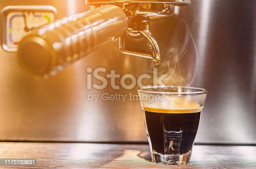 istock Barista making a espresso with a classic coffee machine 1172733831