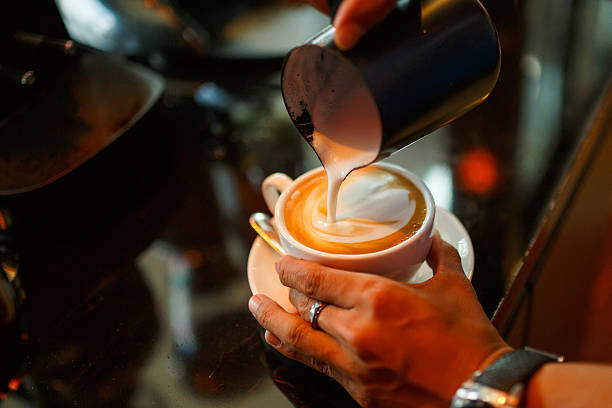 barista making cappuccino in the coffeeshop - barista making coffee stock pictures, royalty-free photos & images