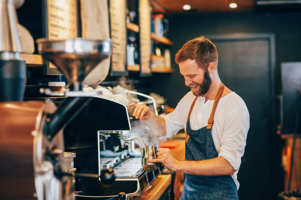 barista making cappuccino - barista making coffee stock pictures, royalty-free photos & images