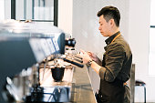 Barista making espresso based drink in a cafe