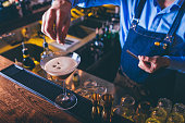 Barista making espresso martini