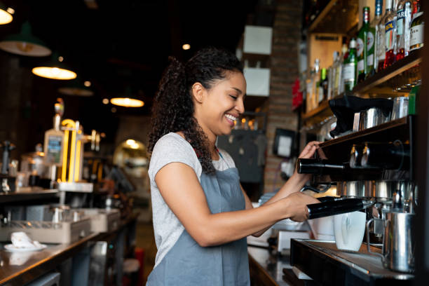 barista making coffee at a cafe - barista making coffee stock pictures, royalty-free photos & images