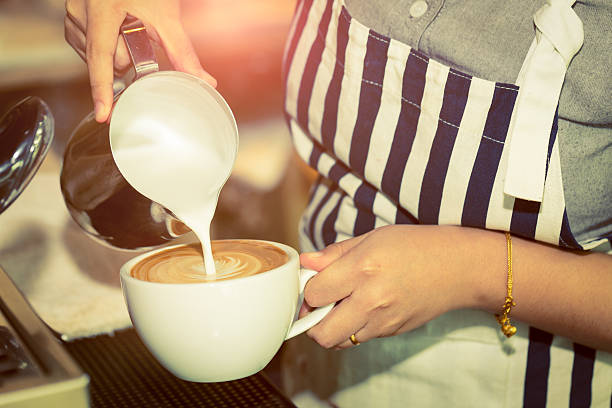 barista making coffee - barista making coffee stock pictures, royalty-free photos & images