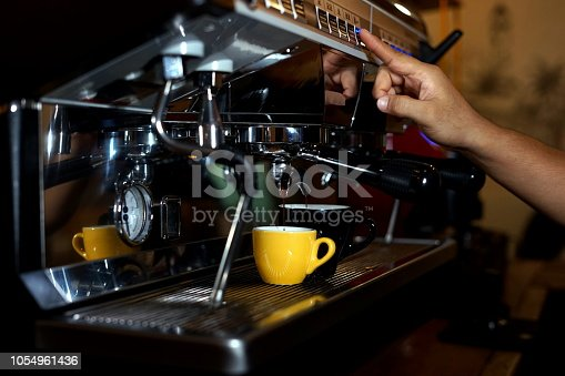 istock Barista making coffee using a coffee maker 1054961436