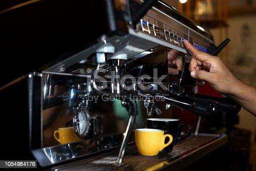 istock Barista making coffee using a coffee maker 1054984176