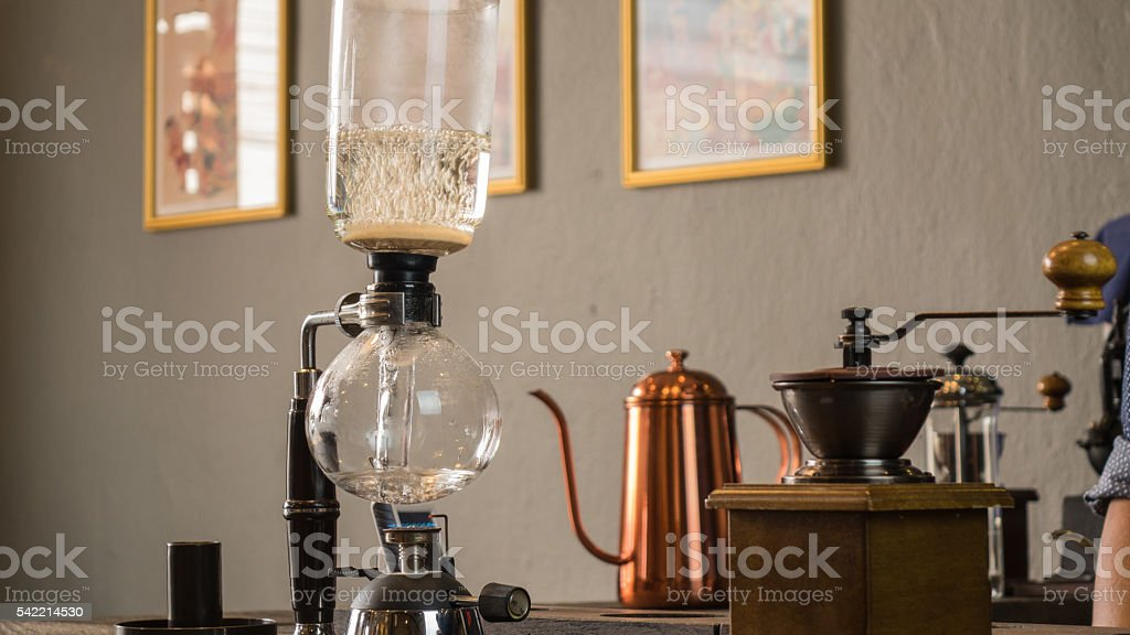 Barista making cup of coffee stock photo