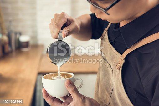 istock Barista making Rosetta shape latte art coffee 1004108444