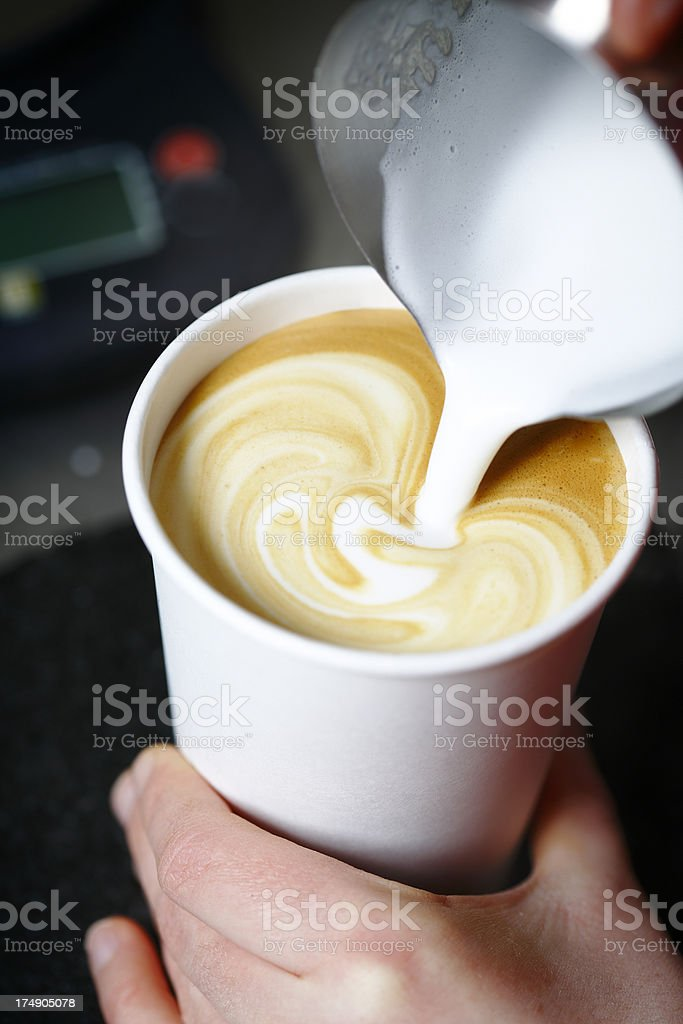 Barista pouring a cafe latte espresso to go stock photo