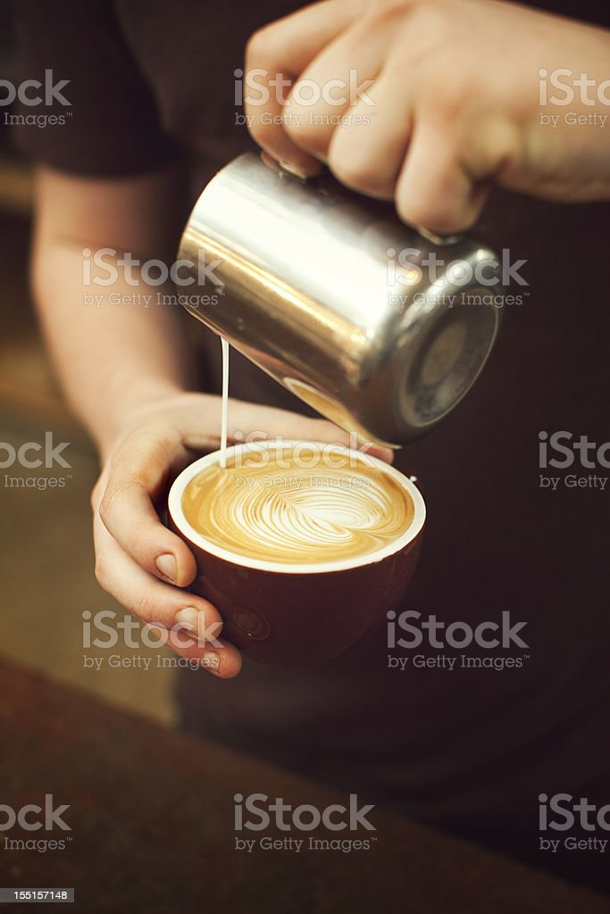 Barista Pouring Froth Art Heart stock photo