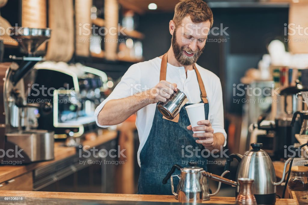 Barista pouring hot coffee stock photo