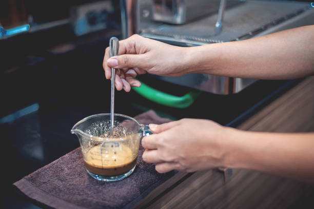 Barista preparing coffee for make iced coffee stock photo