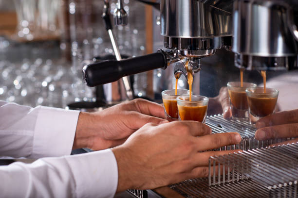 Barista preparing espresso in coffee machine