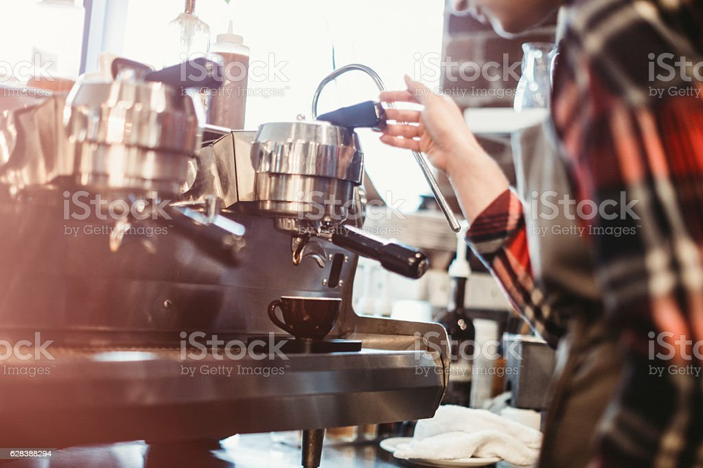 Barista Pulling Shot of Espresso stock photo