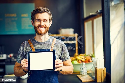 istock Barista showing digital tablet with blank screen 542553522