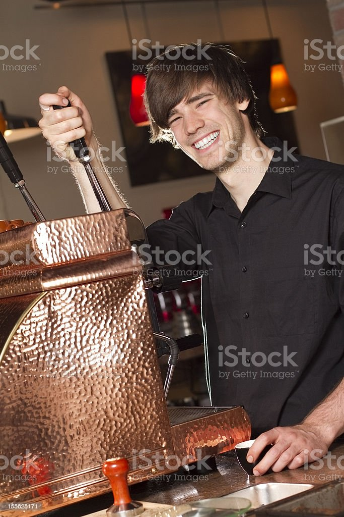 Barista Smiles at Work royalty-free stock photo