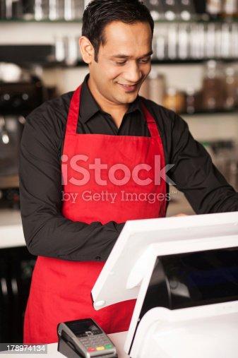 178974134istockphoto Barista staff placing customers order in queue 178974134