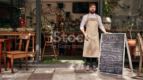 istock Barista standing in the doorway of a restaurant 503865410