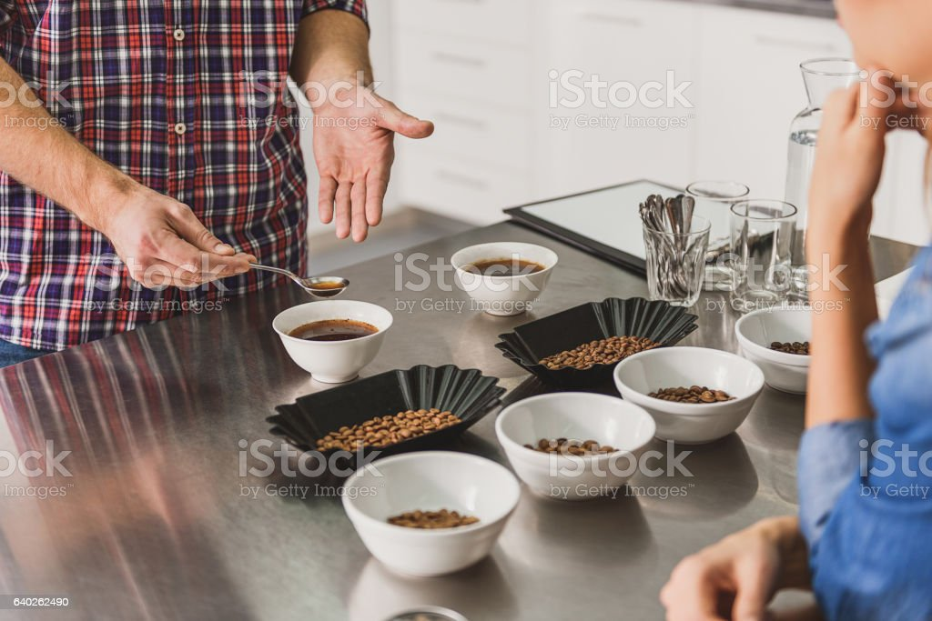 Barista taking spoon with coffee - foto stock